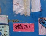 war is terrorism poster on wall